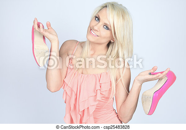 Addicted from high heels woman holding her new shoes - csp25483828