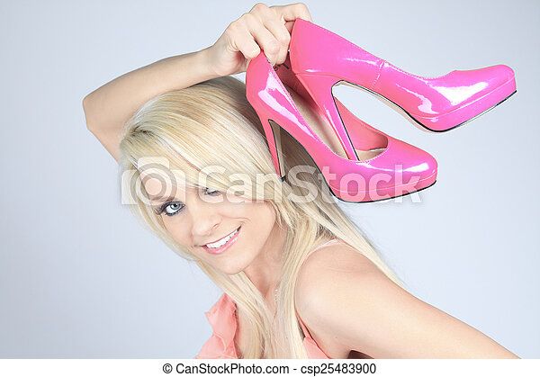 Addicted from high heels woman holding her new shoes - csp25483900