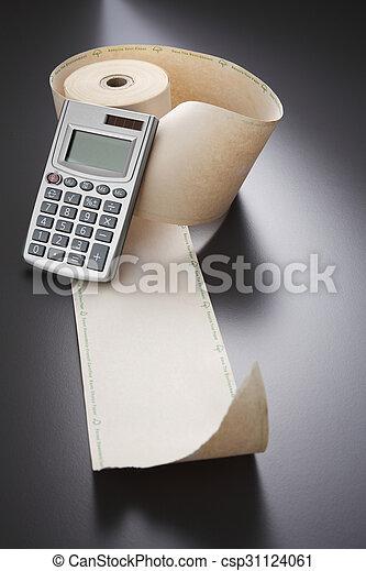 adding machine tape and calculator - csp31124061
