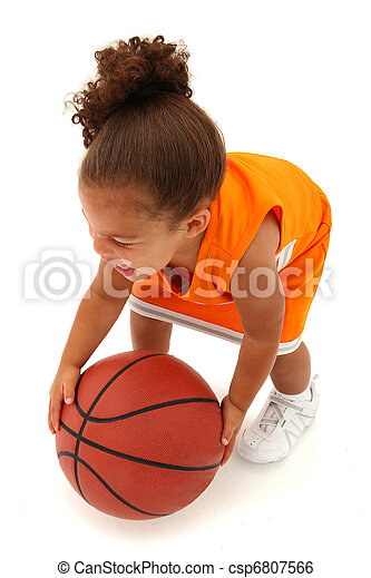 Addorable Toddler Girl Child in Uniform with Basketball - csp6807566