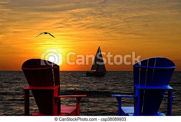 Adirondack chair by lake