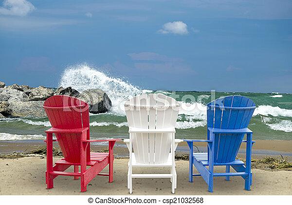 Adirondack chairs on beach - csp21032568