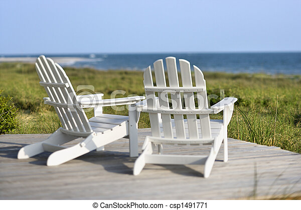 Adirondack chairs on deck looking towards beach on Bald Head Island, North Carolina. - csp1491771