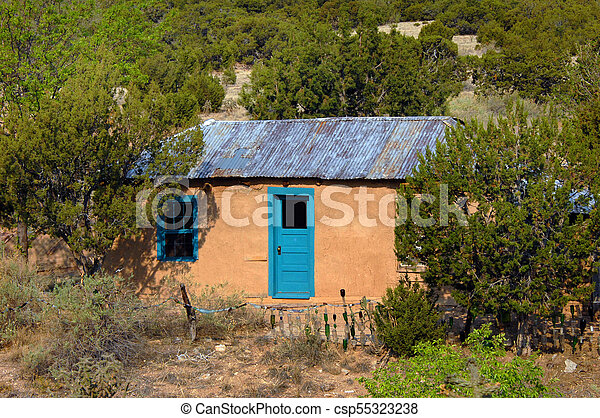 Adobe with tin roof and colorful door small adobe home for Adobe roof