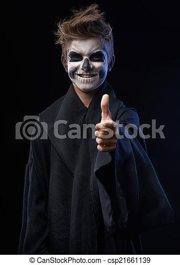 Adolescente con cráneo de maquillaje mostrando pulgares arriba - csp21661139