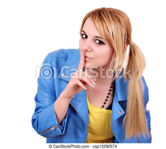 Chica adolescente haciendo gestos de silencio en blanco - csp13290574