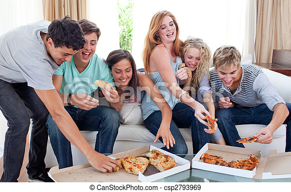 Adolescents eating pizza at home - csp2793969