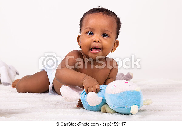 Adorable african american baby girl lying down - csp8453117