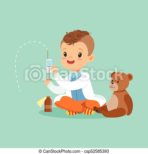 Adorable baby boy dressed as a doctor playing with teddy bear toy. Kid preparing syringe for his sick patient - csp52585393