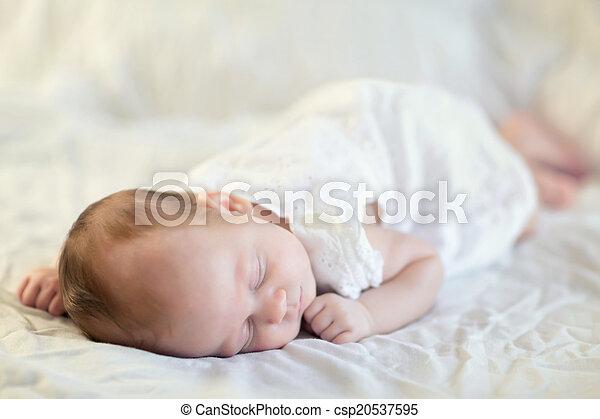 Adorable baby girl sleeping - csp20537595