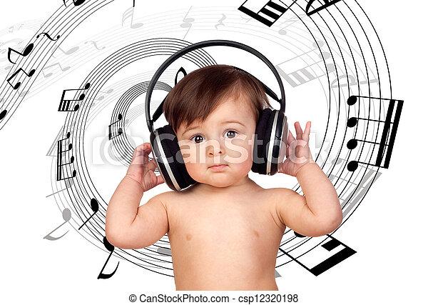 Adorable baby girl with big headphones. Baby girl ...