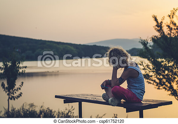 adorable child looking to the sunset - csp61752120