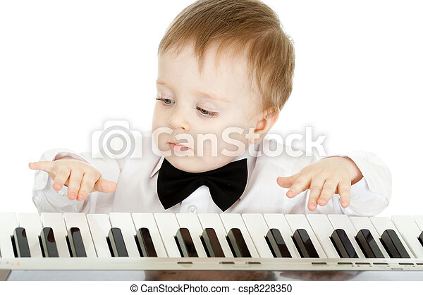 adorable child playing electronic piano - csp8228350