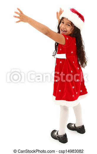 Adorable hispanic preschooler reaching out. Wearing christmas dress and hat. Clipping path. - csp14983082