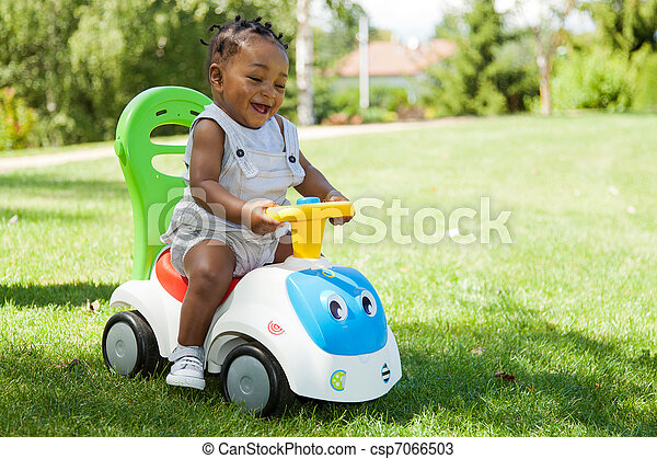 Adorable Little african american baby boy playing - csp7066503
