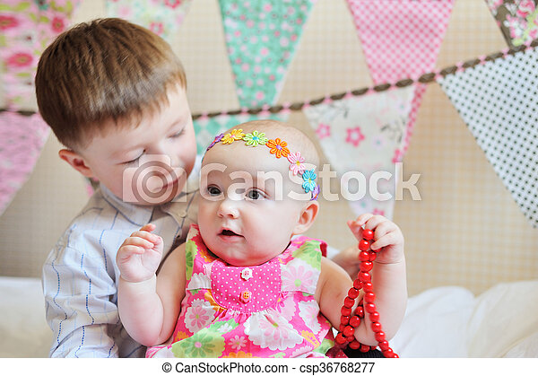Adorable little brother and sister playing together - csp36768277