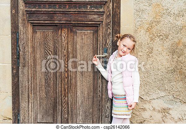 Adorable little girl in a city - csp26142066