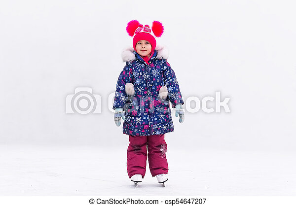 Adorable Little Girl In Winter Clothes And Bobble Hat Skating On Ice