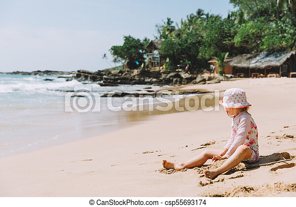 Adorable Little Girl Playing Sand Tropical Beach - csp55693174