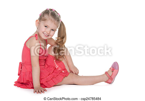 Adorable little girl sits on the floor - csp24785484
