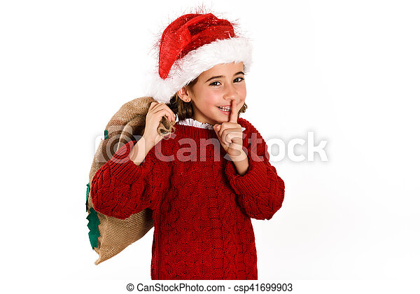 59cfd0997833 Adorable little girl wearing santa hat carrying gift bag isolated on ...