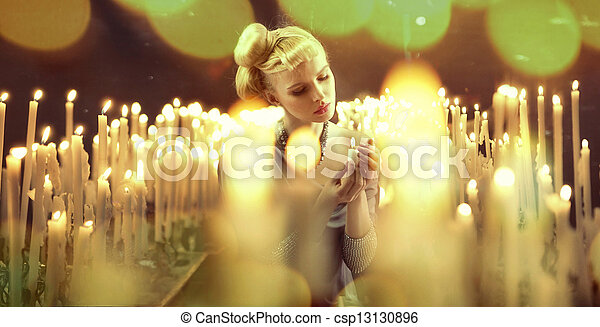 Adorable woman among milions of candles - csp13130896