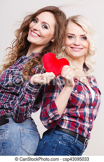 adult daughter and mother with heart love sign - csp43095033
