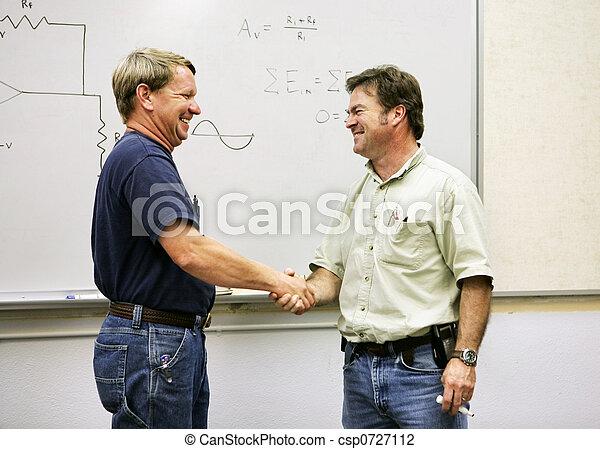 Adult Ed - Handshake - csp0727112
