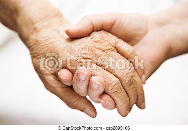 adult helping senior in hospital - csp2093106