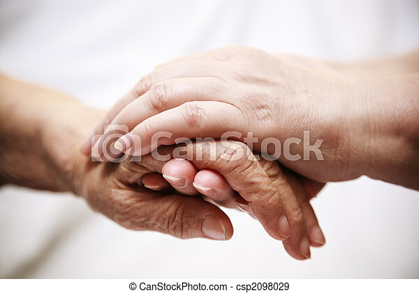adult helping senior in hospital - csp2098029