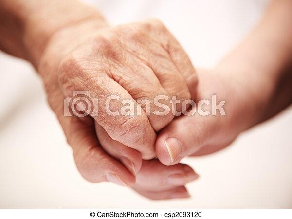 adult helping senior in hospital - csp2093120