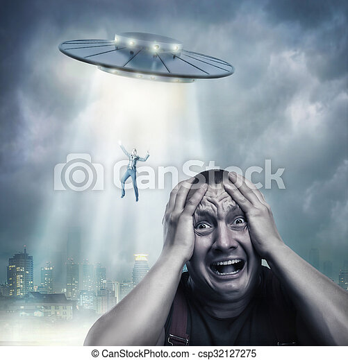 Adult man scared by UFO - csp32127275