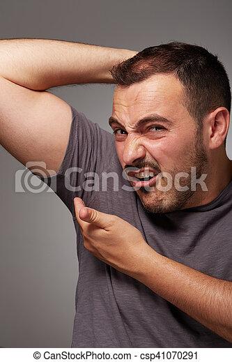 adult man taste his body odor - csp41070291