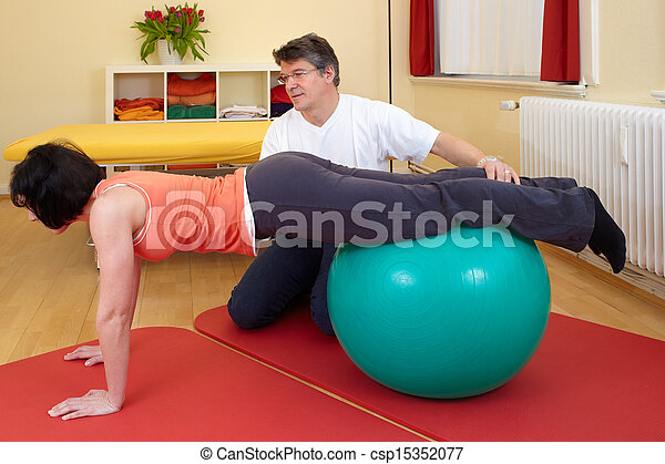 adult practicing poses on exercise ball - csp15352077