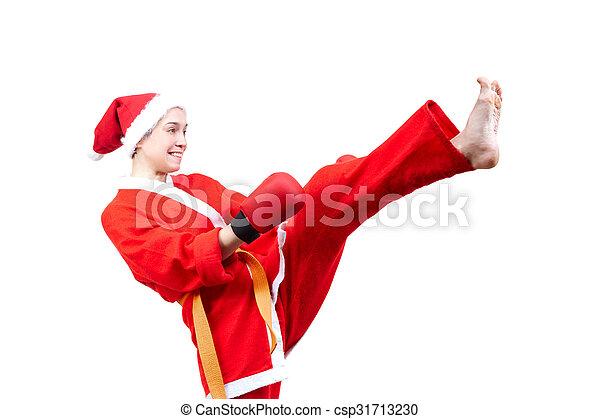Adult sportswoman in dressed Santa - csp31713230