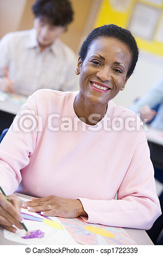 Adult student in class drawing - csp1722339