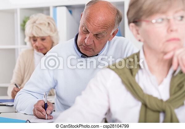 Adult students having test - csp28104799