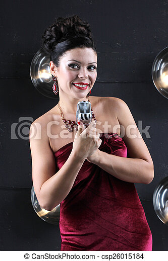 Adult woman with microphone singing - csp26015184