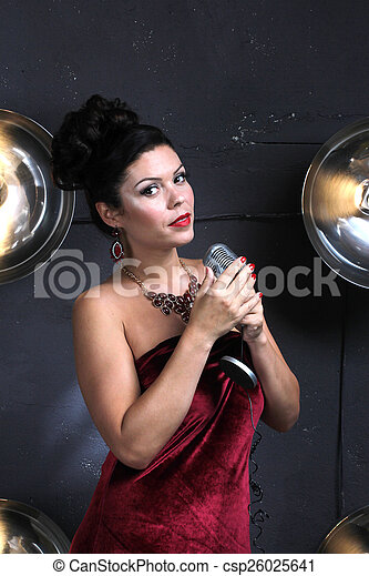 Adult woman with microphone singing - csp26025641