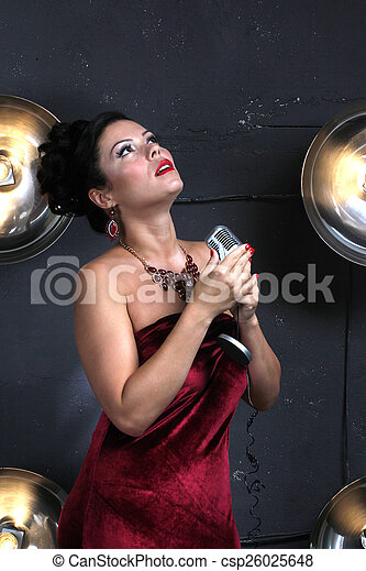 Adult woman with microphone singing - csp26025648