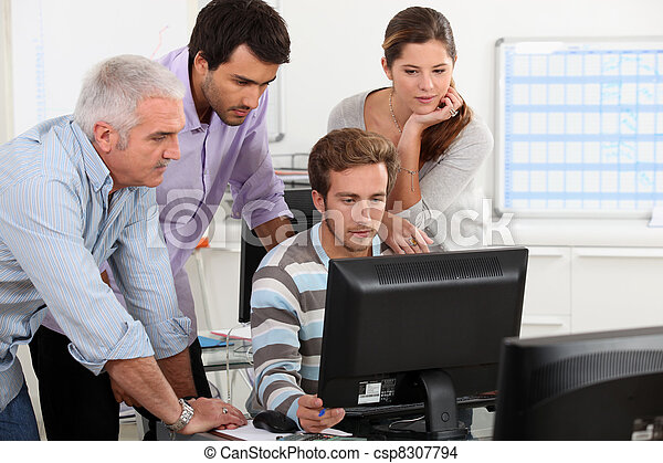 Adults around computer - csp8307794