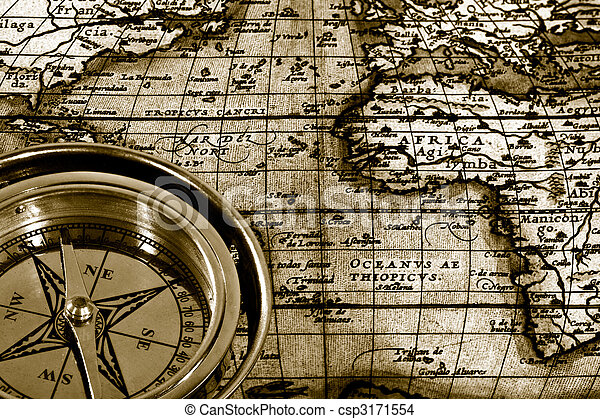 Adventure still life with retro navy compass and map - csp3171554