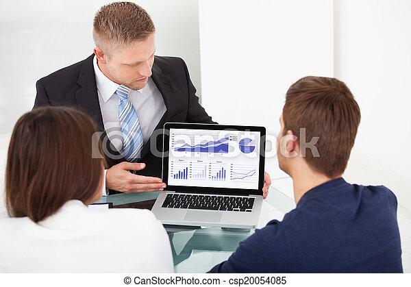 Advisor Explaining Investment Plan To Couple - csp20054085