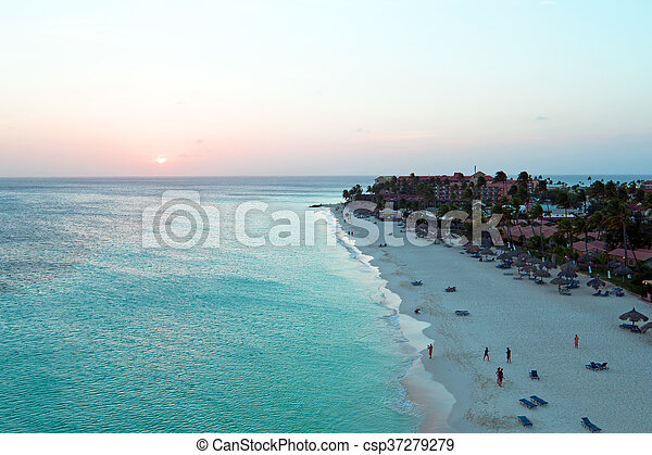 Aerial from a beautiful sunset at Manchebo beach on Aruba island in the Caribbean sea - csp37279279