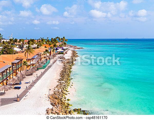 Aerial from Druif beach on Aruba island in the Caribbean - csp48161170