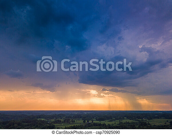 Aerial image of dark Storm clouds in the field - csp70925090