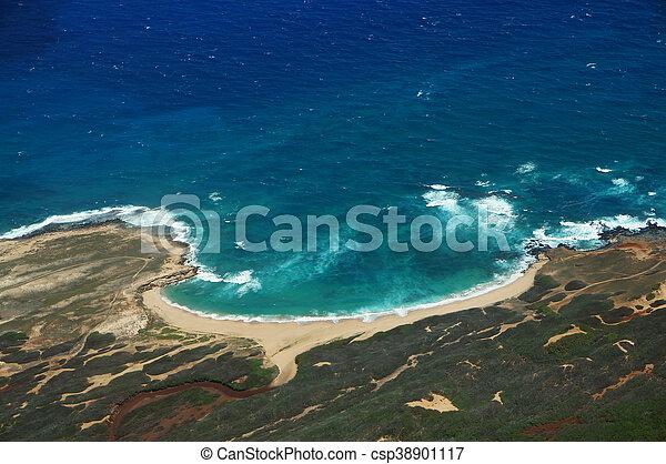 Aerial of coastline of Molokai with waves crashing into Mo'omomi beach - csp38901117