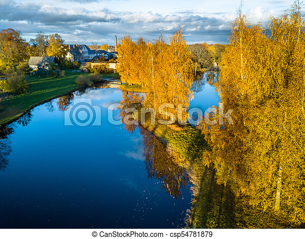 Aerial Photo of a Lake in Sunny Autumn Day - csp54781879