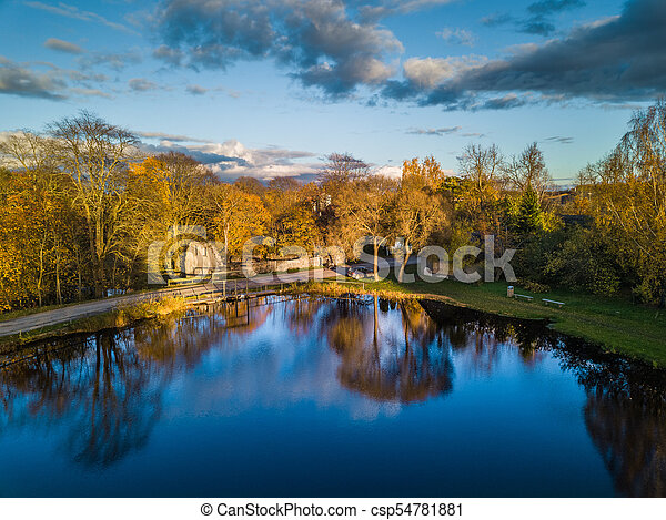 Aerial Photo of a Lake in Sunny Autumn Day - csp54781881
