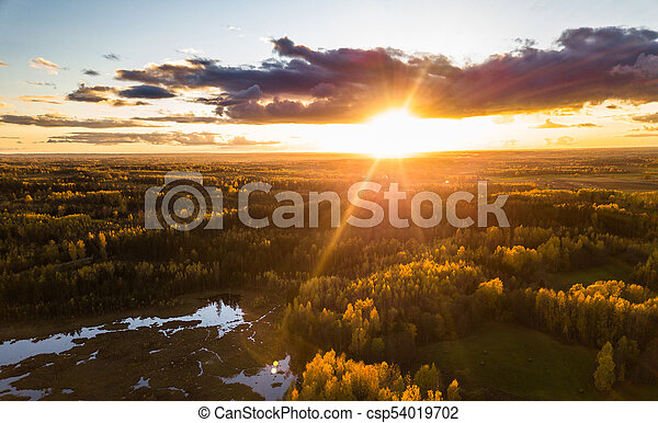 Aerial Photo of a Sunset over Forest in Autumn Day - csp54019702